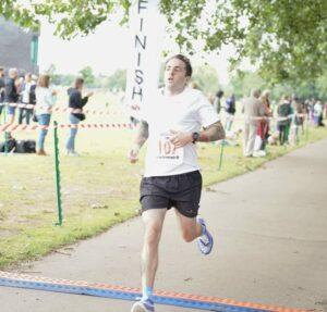 Adam Corbin crosses the line in the Eastleigh 10k