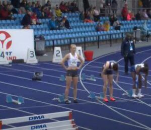 Amelia Verney about to start the Junior 100m at Manchester International