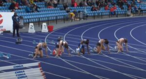 Amelia Verney lining up for the Junior 100m at Manchester International