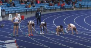 Amelia Verney lines up for the Junior Women's100m atManchester International