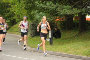 Emma Caplan heading past in the Eastleigh 10k