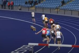 Ollie James jumps a barrier in the 3000m steeple chase