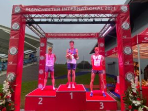 Oliver James on the podium for the 3000m Steeple Chase at Manchester International