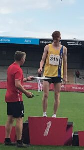 Oliver James on the podium at the Welsh Junior Championships