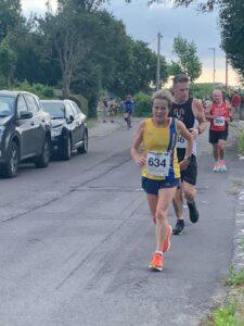 Helen Ambrosen battling hard in the Lytchett 10