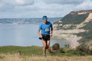Jacek Cieluszecki hits the top of the climb