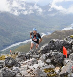 JC reaches the top of the mountain in the Saloman Mamores VK