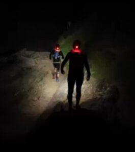 Jacek and Ela make their way down the dark trails