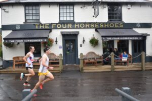 Tag passes the pub in the Lordshill 10k