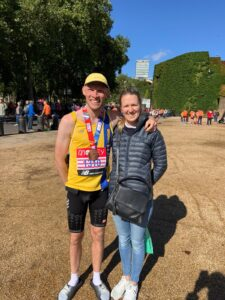 Rob Spencer with partner after London Marathon