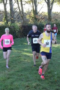 Trev heads across the grass in the Race for the Chase 10k